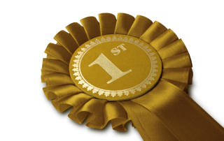 Gold First Rosette, on white, with Clipping Path. Isolated on White